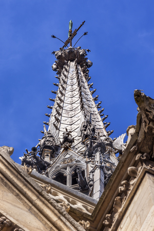 Cathedral Spire Statues Gargoyles Saint Chapelle Paris France.  Saint King Louis 9th created Sainte Chappel in 1248 to house Christian relics, including Christs Crown of Thorns. Editorial