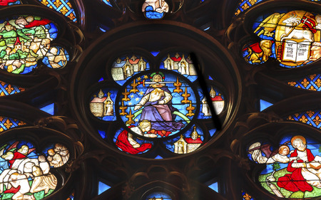 chappel: Jesus Christ With Sword Rose Window Stained Glass Saint Chapelle Paris France.  Saint King Louis 9th created Sainte Chappel in 1248 to house Christian relics, including Christs Crown of Thorns.  Stained Glass created in the 13th Century and shows various