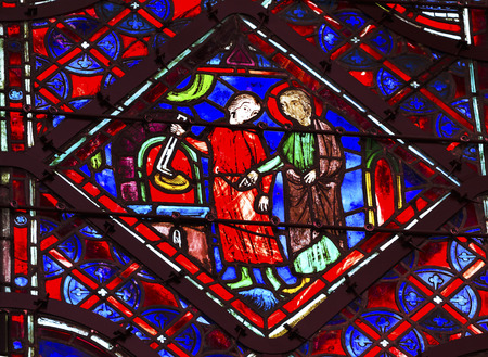 chappel: Crown of Thorns Relic Medieval Life Stained Glass Saint Chapelle Paris France.  Saint King Louis 9th created Sainte Chappel in 1248 to house Christian relics, including Christs Crown of Thorns.  Stained Glass created in the 13th Century and shows various Editorial