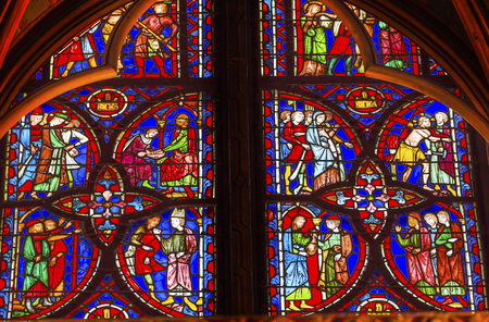 Jesus Crucifixion Story Stained Glass Saint Chapelle Paris France.  Saint King Louis 9th created Sainte Chappel in 1248 to house Christian relics, including Christ's Crown of Thorns.  Stained Glass created in the 13th Century and shows various biblical st Editoriali