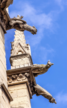 Cathedral Spire Statues Gargoyles Saint Chapelle Paris France.  Saint King Louis 9th created Sainte Chappel in 1248 to house Christian relics, including Christs Crown of Thorns. Stock Photo