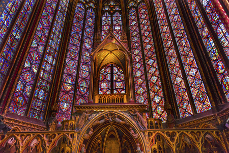 chappel: Stained Glass Cathedral Altar Arch Saint Chapelle Paris France.  Saint King Louis 9th created Sainte Chappel in 1248 to house Christian relics, including Christs Crown of Thorns.  Stained Glass created in the 13th Century and shows various biblical stori Editorial