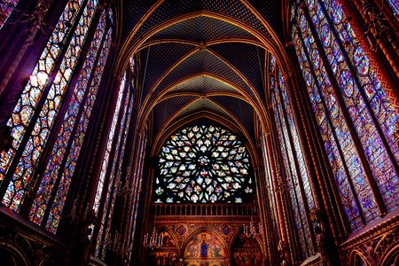 Rose Window Stained Glass Cathedral Ceiling Saint Chapelle Paris France.  Saint King Louis 9th created Sainte Chappel in 1248 to house Christian relics, including Christs Crown of Thorns.  Stained Glass created in the 13th Century and shows various bibli
