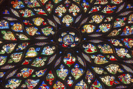 chappel: Jesus Christ With Sword Surrounded by Biblical and Medieval Stories Angels, Mary Rose Window Stained Glass Saint Chapelle Paris France.  Saint King Louis 9th created Sainte Chappel in 1248 to house Christian relics, including Christs Crown of Thorns.  St