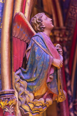 9th: Angel Wood Carving Cathedral Saint Chapelle Paris France.  Saint King Louis 9th created Sainte Chappel in 1248 to house Christian relics, including Christs Crown of Thorns.  Stained Glass created in the 13th Century and shows various biblical stories alo