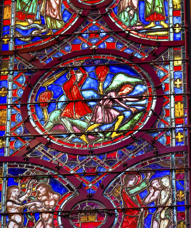 chappel: Cain Abel Adam Eve Stained Glass Saint Chapelle Paris France.  Saint King Louis 9th created Sainte Chappel in 1248 to house Christian relics, including Christs Crown of Thorns.  Stained Glass created in the 13th Century and shows various biblical stories Editorial