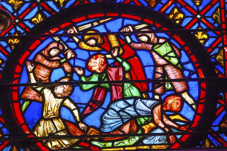 beheading: Knights Beheading Medieval Life Stained Glass Saint Chapelle Paris France.  Saint King Louis 9th created Sainte Chapelle in 1248 to house Christian relics, including Christs Crown of Thorns.  Stained Glass created in the 13th Century and shows various bi Editorial
