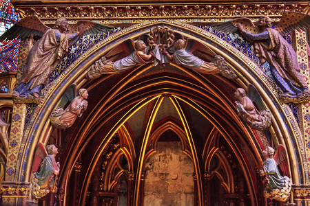 9th: Angels Wood Carvings Cathedral Saint Chapelle Paris France.  Saint King Louis 9th created Sainte Chapelle in 1248 to house Christian relics, including Christs Crown of Thorns.  Stained Glass created in the 13th Century and shows various biblical stories