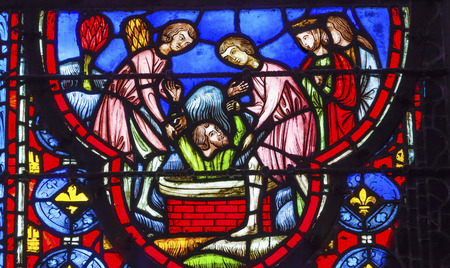 9th: Baptising King Stained Glass Saint Chapelle Paris France.  Saint King Louis 9th created Sainte Chapellel in 1248 to house Christian relics, including Christs Crown of Thorns.  Stained Glass created in the 13th Century and shows various biblical stories a Editorial