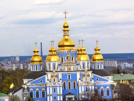 saint michael: Saint Michael Monastery Cathedral Steeples Spires Tower Golden Dome Facade Kiev Ukraine.  Saint Michaels is a functioning Greek Orthordox Monasatery in Kiev.  The original monastery was created in the 1100s but was destroyed by the Soviet Union in the 19