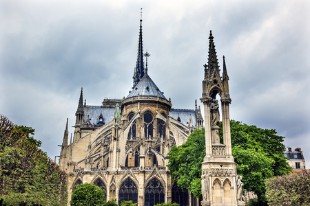 buttresses: Rear Back Overcast Skies Flying Buttresses Notre Dame Cathedral Paris France.  Notre Dame was built between 1163 and 1250AD.