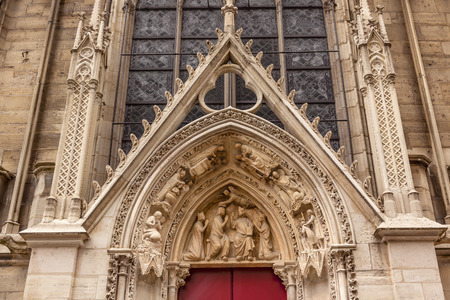 red door: Biblical Statues Little Red Door Notre Dame Cathedral Paris France.  Notre Dame was built between 1163 and 1250AD.