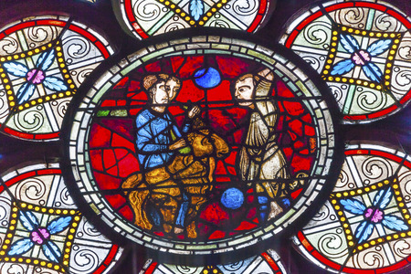 parable: Lost Sheep Parable Jesus Christ Stained Glass Notre Dame Cathedral Paris France.  Notre Dame was built between 1163 and 1250 AD. Editorial
