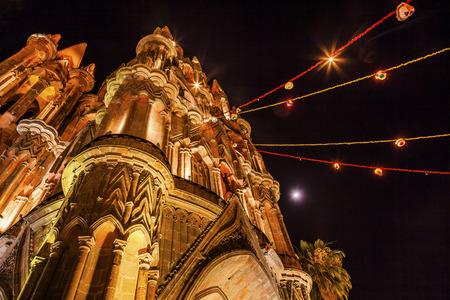 Facade Night Moon Parroquia Christmas Archangel church San Miguel de Allende, Mexico. Parroaguia created in 1600s and facade created in 1880s.