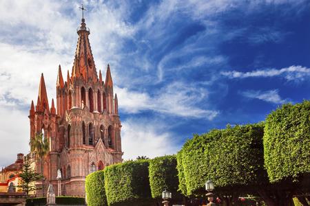history building: Parroquia Archangel church Jardin Town Square San Miguel de Allende, Mexico. Parroaguia created in 1600s.