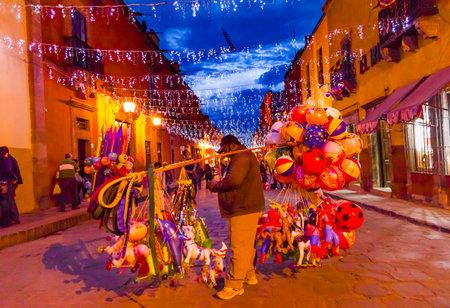 Balloon Seller Night Lights Shops Nightlife San Miguel de Allende, Mexico.