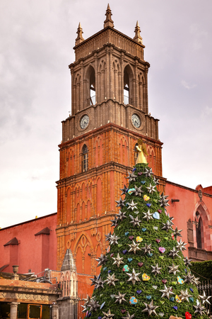 religious building: Rafael Church Tower Temple de San Rafael Christmas Tree El Jardin San Miguel de Allende, Mexico. Stock Photo