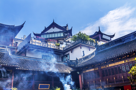 spirtual: Taoist Roofs City God Temple Incense Smoke Yueyuan Shanghai China.  Most famous Taoist temple in Shanghai Stock Photo