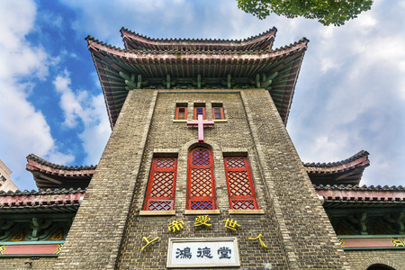 bible and cross: Old Hongde Tang Fitch Memorial Christian Protestant Church Duolon Cultural Road Hongkou District Shanghai China. Hongde Tang was created in 1928.  Old Christian church in Shanghai built to look like a Chinese temple.