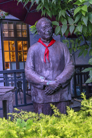spirtual: Writers Statue, red scarf Stock Photo