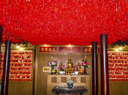 spirtual: Guanyin Goddess of Mercy Taoist God Statue With Red Requests Roof City God Temple Yueyuan Shanghai China Most famous Taoist temple in Shanghai