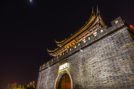 moon gate: Moon City Wall Ancient Gate to Water Canal Water Gate Near Nanchang Temple Wuxi Jiangsu Province, China.  Wuxi, one of the oldest cities in China, is a canal city.  Gate is entrance to Canal.  Chinese characters are not trademarks. desribe the Gate