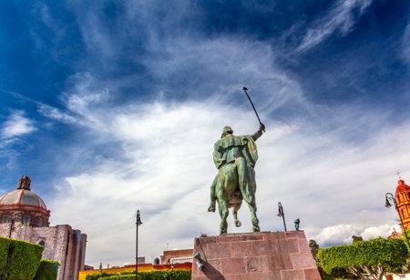 revolt: General Ignacio Allende Statue Plaza Civica San Miguel de Allende Mexico. Iglesia De Nuestra Senora De La Salud Church General who first led revolt against Spain in 1810 and considered a hero of the Mexican War of Independence