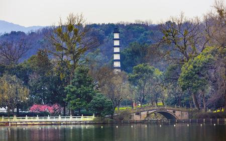 liu: Old Chinese White Pagoda Liu Zhuang Garden Plum Blossoms West Lake Hangzhou Reflection Zhejiang China .