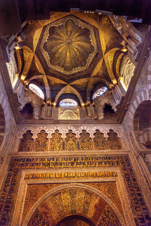 Mihrab Moslem Islam Prayer Niche Golden Dome Arches Mezquita Cordoba Spain.  Mezquita Created in 785 as a Mosque. Mezquita converted to a Cathedral in 1500.