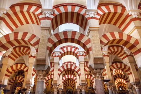 pillar: Arches Pillars Mezquita Cordoba Spain.  Created in 785 as a Mosque, was converted to a Cathedral in the 1500.  850 Columns and Arches
