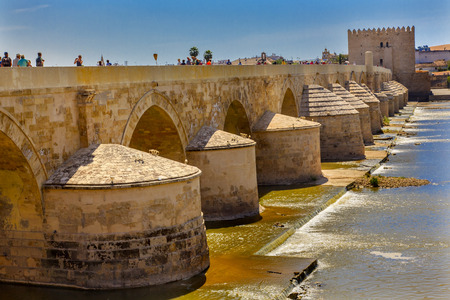 1st century: Ancient Roman Bridge Entrance River Guadalquivir Cordoba Spain  Roman bridge was built in the 1st Century BC.
