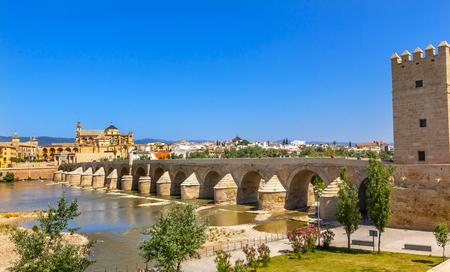 1st century: Ancient Roman Bridge Entrance Calahorra Tower Puerta del Puente Mezquita River Guadalquivir Cordoba Spain  Roman bridge was built in the 1st Century BC. Stock Photo