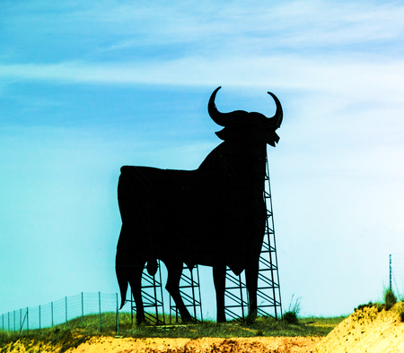 fighting bulls: Osborne Sherry Black Bull Sign Advertising Cordoba Spain.  Symbol of Spain Seen on Every Highway throughout Spain