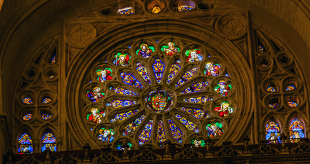 jesus rose: Rose Window Coat Arms Jesus Saints Stained Glass Cathedral Spanish Flag Toledo Spain.  Cathedral started in 1226 finished 1493