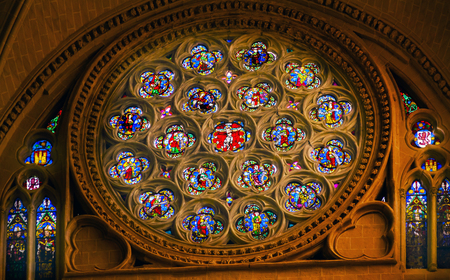 disciples: Rose Window Jesus Christ Saints Disciples Mary Stained Glass Cathedral Spanish Flag Toledo Spain.  Cathedral started in 1226 finished 1493