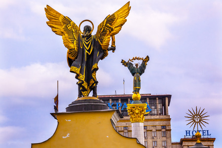 saint michael: Laches Gate Saint Michael Peasant Girl Slavic Goddess Berehynia Statue on top Independence Monument, Symbol of Ukraine Independence and Orange Revolution, Maidan Square Kiev Ukraine