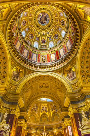 consecrated: Dome God Christ Basilica Arch Saint Stephens Cathedral Budapest Hungary.  Saint Stephens named after King Stephens who brought Christianity to Hungary.  Cathedral built in the 1800s and consecrated in 1905.