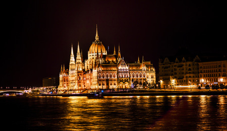 Parliament Building Boats Margaret Bridge Danube River Reflection Budapest Hungary.  Parliament Building built betwwn 1885 to 1904.