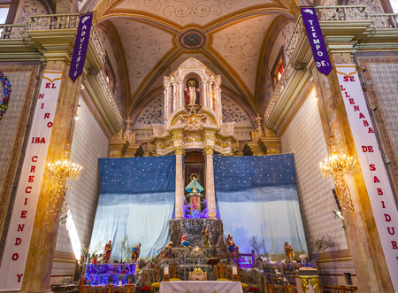 creche: Altar Christma Creche Mary Parroquia Cathedral Dolores Hidalgo Mexico. Where Father Miguel Hidalgo made his Grito de Dolers starting the 1810 War of Independence in Mexico.  Cathedral built in the 1700s. Signs say Advent, Baby in Manger and other Christma