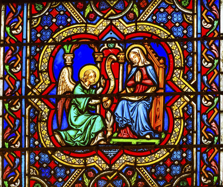 annunciation of mary: Annunciation Angel Gabriel Telling Virgin Mary About Jesus Stained Glass Notre Dame Cathedral Paris France.  Notre Dame was built between 1163 and 1250 AD. Editorial