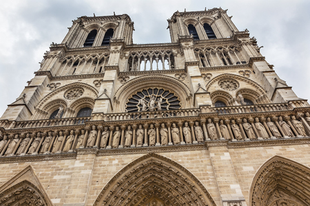 craftmanship: Facade Towers Overcast Skies Notre Dame Cathedral Paris France.  Notre Dame was built between 1163 and 1250AD.
