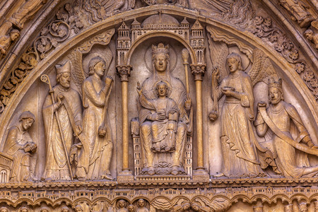 craftmanship: Saint Anne Door Biblical Statues Virgin Mary Baby Jesus Bishop Angels Notre Dame Cathedral Paris France.  Notre Dame was built between 1163 and 1250AD.