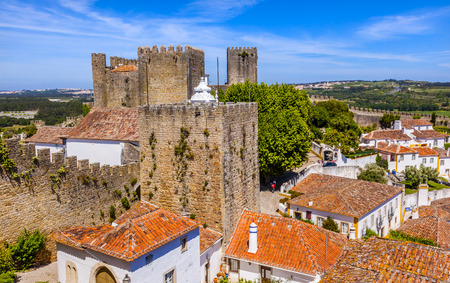 11th: Castle Wals Turrets Towers Medieval Town Obidos Portugal. Castle and walls built in 11th century after town taken from the Moors. Editorial