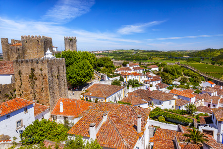 turrets: Castle Wals Turrets Towers Medieval Town Obidos Portugal. Castle and walls built in 11th century after town taken from the Moors. Editorial
