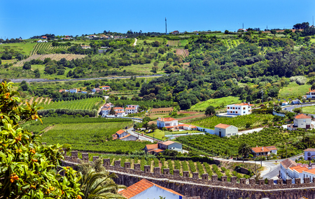 moors: Castle Wals Countryside Farmland Medieval Town Obidos Portugal. Castle and walls built in 11th century after town taken from the Moors.