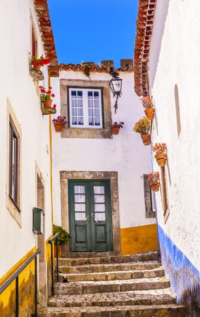 11th century: Narrow White Street 11th Century Medieval Town Obidos Portugal.