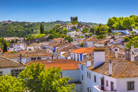 11th century: Castle Wals Turrets Towers Medieval Town Obidos Portugal. Castle and walls built in 11th century after town taken from the Moors. Editorial