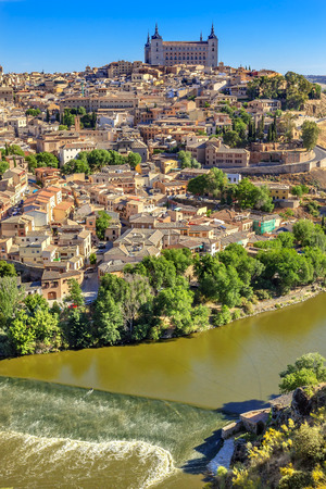 is Alcazar Fortress Medieval City Tagus River Toledo Spain.  Toledo Alcazar built in the 1500s, Destroyed in Spanish Civil War and then rebuilt after war. Unesco historical site; Tagus is longest river in Spain.