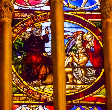 lazarus: Jesus Blessing Lazarus Stained Glass Cathedral Spanish Flag Toledo Spain.  Cathedral started in 1226 finished 1493 Editorial