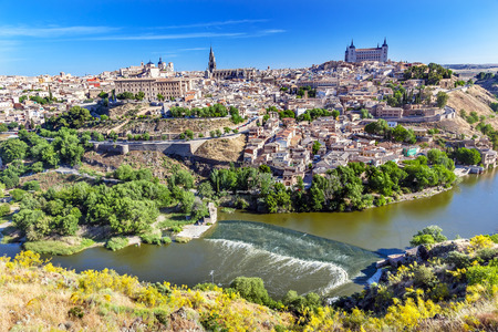 is Alcazar Fortress Churches Cathedral Medieval City Tagus River Toledo Spain.  Toledo Alcazar built in the 1500s, Destroyed in Spanish Civil War and then rebuilt after war. Unesco historical site; Tagus is longest river in Spain. Editorial